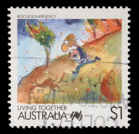 philatelic: Stamp printed in Australia shows Living Together cartoons Rescue and Emergency, circa 1988