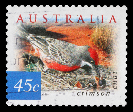 tricoloured: Stamp printed in AUSTRALIA shows the Crimson Chat, Fauna and Flora, series, circa 2001