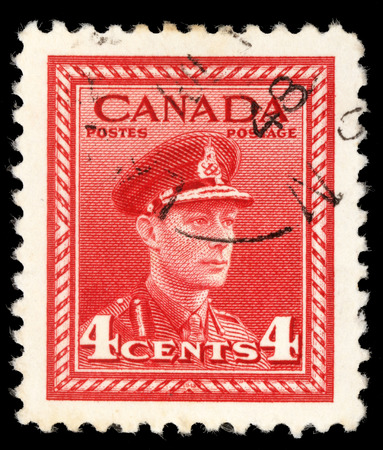 postes: Stamp printed in Canada from the  War Effort  issue shows King George VI in Military Uniform, circa 1942