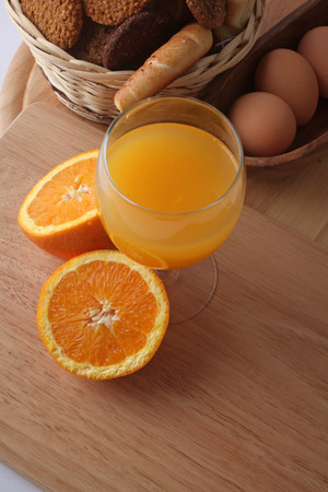Breakfast with juice, milk, fruits and eggs photo