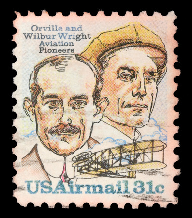 pioneers: Stamp printed in USA shows image of the brothers Orville and Wilbur Wright - American aviation pioneers, circa 1995