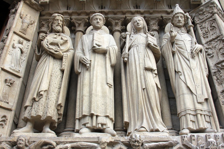 saint stephen cathedral: Paris, Notre-Dame cathedral, portal of the Virgin, from left to right: Saint John the Baptist, Saint Stephen, Saint Genevieve and Pope Saint Sylvester. Editorial