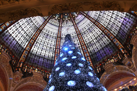 christmas perfume: The Christmas tree at Galeries Lafayette, trade pavilions with perfume, November 11, 2012, Paris, France. Many famous perfume brands represent their production here. Editorial