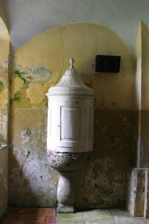 baptismal: Baptismal font in old church Editorial