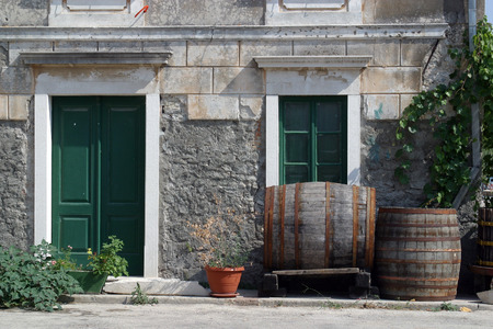 front house: Barrels in front of house