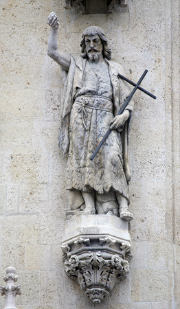 Statue of a saint John The Baptist above the portal of the gothic cathedral dedicated to the Assumption of Mary and to kings Saint Stephen and Saint Ladislaus in Zagreb, Croatia Stock Photo
