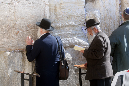 Jewish men pray at the western wall January 02, 2008 in Jerusalem, IL  The wall is one of the holiest sites in Judaism attracting thousands of worshipers daily Editorial