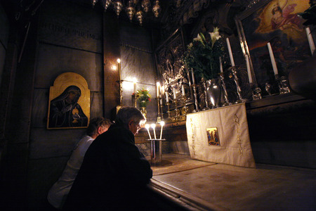 sepulchre: Pilgrims pray at the tomb of Jesus in the Church of the Holy Sepulchre, traditional site of the crucifixion, burial, and resurrection of Jesus, on October 01, 2006  Editorial