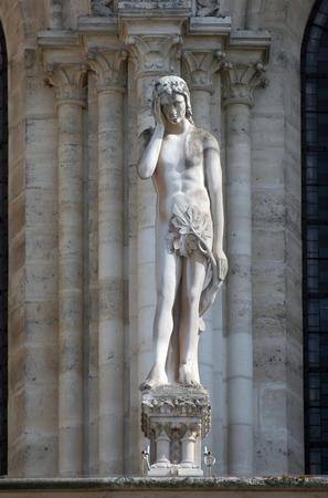 Statue of Adam, Notre Dame Cathedral, Paris photo