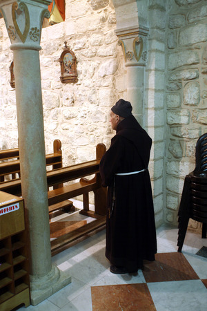 first miracle: Franciscan monk in the Church of Jesus  first miracle  Franciscans in the Holy Land take care about most of the churches and shrines , Cana, Israel on December 30, 2007