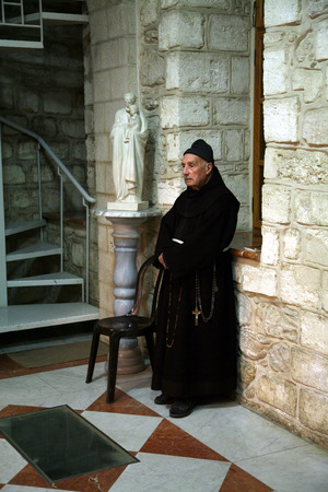 Franciscan monk in the Church of Jesus  first miracle  Franciscans in the Holy Land take care about most of the churches and shrines , Cana, Israel on December 30, 2007