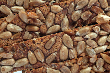 Sliced bread with sunflower seeds photo