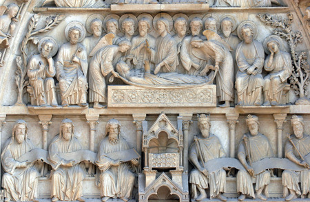 Notre Dame Cathedral, Paris. The Portal of the Virgin. Death of the Virgin Mary photo