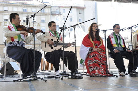 Members of folk group Payiz from Sulaimaniya, Kurdistan, Iraq during the 48th International Folklore Festival in center of Zagreb, Croatia on July 18, 2014