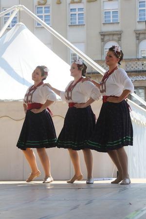ensemble: Folk group Selkirk, Manitoba, Ukrainian Dance Ensemble Troyanda from Canada during the 48th International Folklore Festival in center of Zagreb, Croatia on July 18, 2014