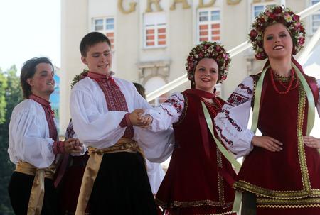 Folk group Selkirk, Manitoba, Ukrainian Dance Ensemble Troyanda from Canada during the 48th International Folklore Festival in center of Zagreb, Croatia on July 18, 2014