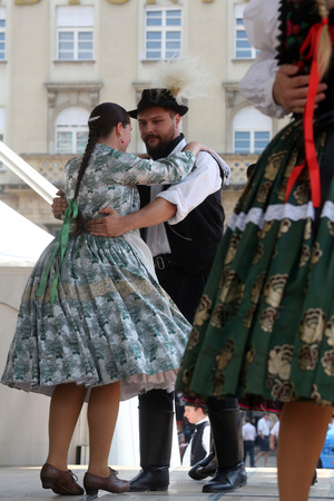 Members of folk groups Nograd  from Salgotarjan, Hungary during the 48th International Folklore Festival in center of Zagreb, Croatia on July 19, 2014