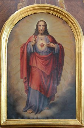 Sacred Heart of Jesus, the altarpiece in the church of St. Aloysius in Travnik, Bosnia and Herzegovina on June 11, 2014. 免版税图像