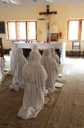 house of prayer: Sisters of Mother Teresa Missionaries of Charity in prayer in the chapel of the Mother House, Kolkata, India at February 08, 2014. Editorial
