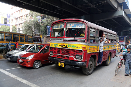 transportaion: People on the move come in the colorful bus on February 10, 2013 in Kolkata, India. Kolkata and its suburbs, is home to approximately 14.1 million people.