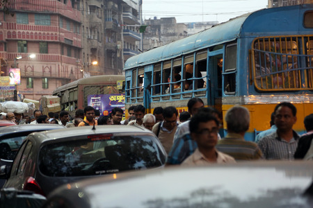 kolkata: Dark city traffic blurred in motion at late evening on crowded streets on February 10, 2014 in Calcutta. Kolkata has a density of 814.80 vehicles per km road length
