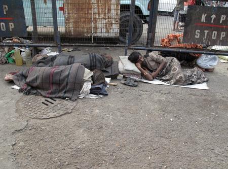 calcutta: Homeless people sleeping on the footpath of Kolkata.