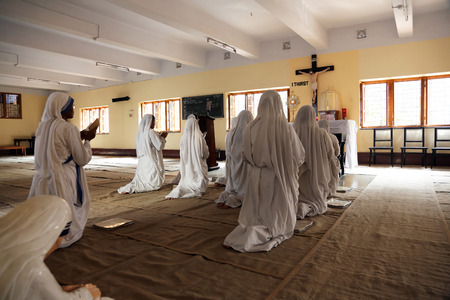 house of prayer: Sisters of Mother Teresas Missionaries of Charity in prayer in the chapel of the Mother House, Kolkata, India at February 08, 2014.