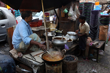 Father and son prepares simple street food outdoor on February 10 2014 in Kolkata. Third biggest indian city Kolkata with its suburbs is home to approximately 14.1 mill.people