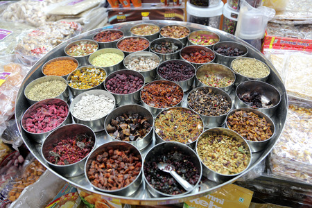 calcutta: Different spices and herbs in metal bowls on a street market in Kolkata, India
