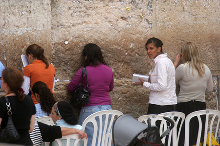 Jewish women pray at the western wall October 03, 2006 in Jerusalem, IL. The wall is one of the holiest sites in Judaism attracting thousands of worshipers daily.