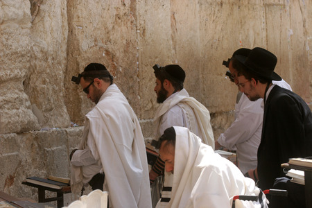 Jewish men pray at the western wall October 03, 2006 in Jerusalem, IL. The wall is one of the holiest sites in Judaism attracting thousands of worshipers daily.