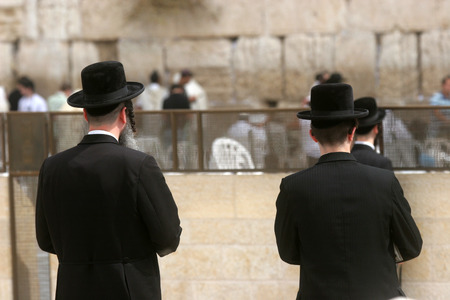 worshipers: Jewish men pray at the western wall October 03, 2006 in Jerusalem, IL. The wall is one of the holiest sites in Judaism attracting thousands of worshipers daily.