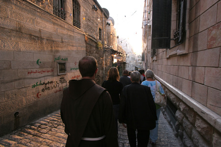holy land: Via Dolorosa. The pilgrims who visit the Holy Land, pass the path that Jesus carried the cross to Calvary. Jerusalem on October 03, 2006.
