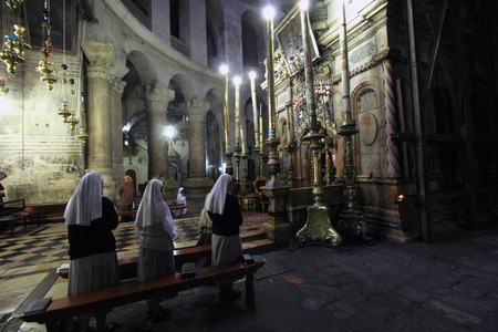 Early in the morning before the arrival of pilgrims from around the world, nuns praying in the Church of the Holy Sepulchre, October 04, 2006 in Jerusalem, Israel.