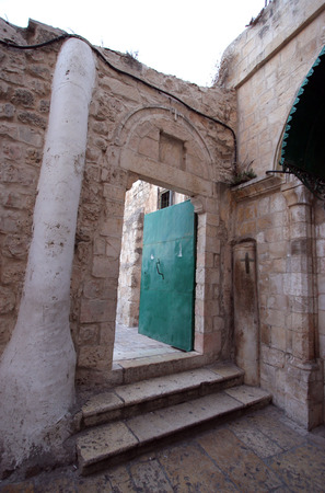 Door in ethiopian monestary, church of the Holy Sepulchre, Jerusalem, Israel photo