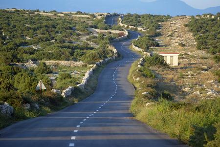 Asphalt winding road, Island of Pag, Croatia. photo