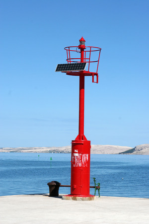 Small red lighthouse along Adriatic coasts photo