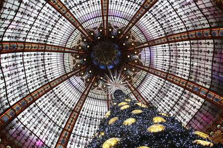 christmas perfume: The Christmas tree at Galeries Lafayette, trade pavilions with perfume, November 11, 2012, Paris, France. Many famous perfume brands represent their production here. Stock Photo