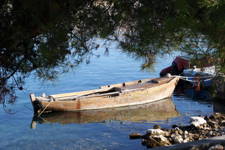 A wooden rowing boat tide down photo