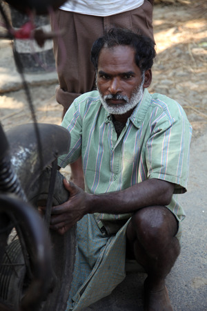 Mechanic repair the motorbike. Bikes is the common individual transport in India.