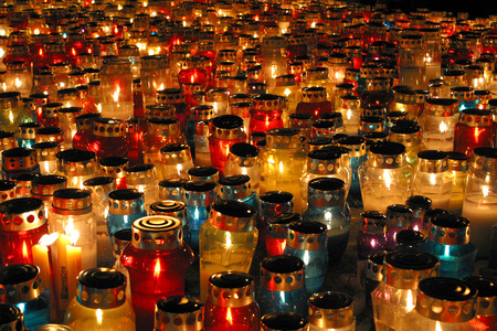 all saints day: Memorial candles shining at the cemetery on the All Saints Day