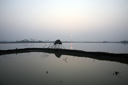 holiest: A stunning sunrise looking over the holiest of rivers in India. Ganges delta in Sundarbans, West Bengal, India. Stock Photo