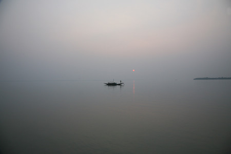 holiest: A stunning sunset looking over the holiest of rivers in India. Ganges delta in sundarbans, West Bengal, India Stock Photo