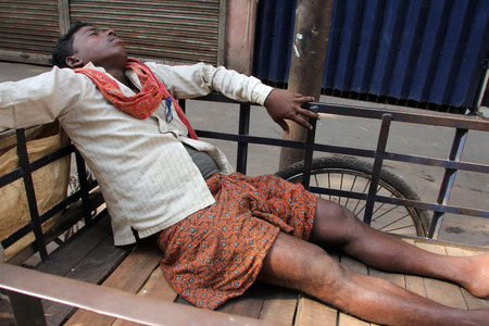 beggary: Homeless people sleeping on the footpath of Kolkata. on November 28, 2012 in Kolkata, India.
