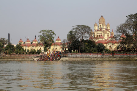 kali: Hindu people bathing in the ghat near the Dakshineswar Kali Temple on February 14, 2014. The beautiful temple was built in Bengal architecture style in 1855 Editorial
