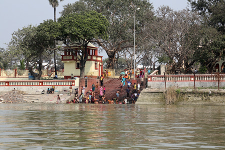 west bengal: Hindu people bathing in the ghat near the Dakshineswar Kali Temple on February 14, 2014. At present time this river is being polluted tremendously. Editorial