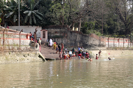 kali: Hindu people bathing in the ghat near the Dakshineswar Kali Temple on February 14, 2014. At present time this river is being polluted tremendously. Editorial