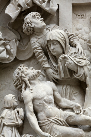 lamentation: Lamentation of Christ Architectural details from the external walls of St Stephen\s Cathedral in Vienna, Austria Stock Photo