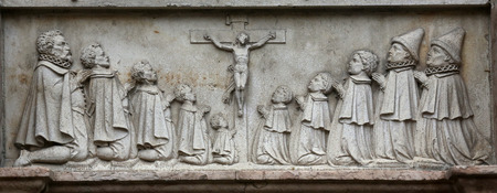 bas relief: An old crucifixion relief sculpture outside St. Stephens Cathedral in Vienna, Austria on October 10, 2014