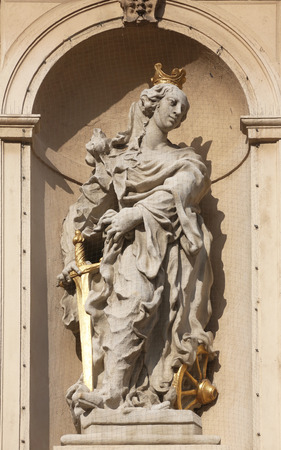 Saint Catherine of Alexandria on baroque Jesuits church in Vienna, Austria photo